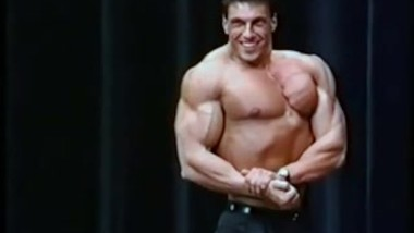 Vintage Bodybuilder Posing on Stage