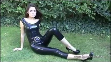 Outdoor latex fetish babe Anastasia posing in fetish wear so