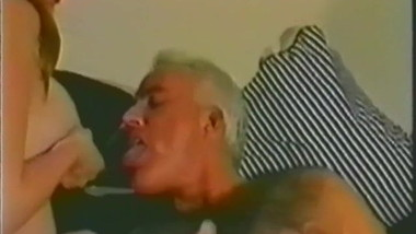 WOMAN BREASTFEEDS OLD MAN
