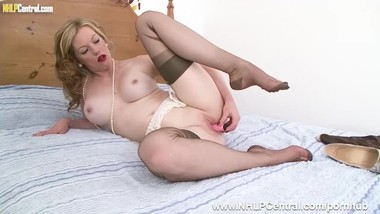 Milf Holly Kiss takes of nylon slip panties heels fucks dildo in stockings