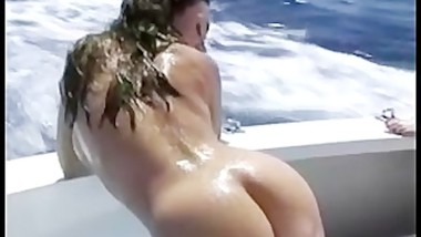 Hot girls get nude and fuck on a boat